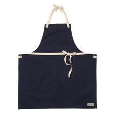 Story  What's for dinner?  The Reggie Bib Apron is built in Jones' classic bib style. Full coverage, with adjustable straps tied at neck and waist. Features  Navy Canvas 100% Cotton 10 oz. Indigo Denim Heavy Duty Antique Brass Grommets Small Chest Pocket w/ pen holder Large Hip Pocket, with three separate storage compartments Adjustable Brown Cotton Twill Tape ties at neck and waist Made in NYC  One size fits all  Materials   100% Cotton 10 oz. Indigo Denim  Sizing   One ...