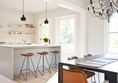 modern kitchen: pale colors and clean lines make mid century furniture and lighting pop, maple shelves soften the look ever so slightly
