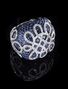 Sapphire and White Diamond Ring totaling 9.16 carats, handcrafted in 18 karat white gold.