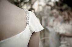 alma aguilar-  pretty crystal detail on wedding gown shoulder  From oncewed.com  via Maria Antonia Pastor