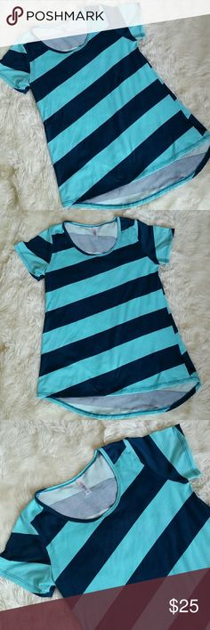Lularoe Classic Tee Diagonal Stripes Size Small Lularoe Classic Tee in Diagonal Stripes Blue Size Small. Shades of Robins egg and dark sea blue take turns making thick diagonal stripes in this fun Irma. Preowned in great condition with no rips, holes, tears or stains. No fading and no piling. Size small. LuLaRoe Tops Tees - Short Sleeve