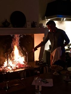 Oddur firing up a bundle of dried sarments to grill beef steaks & duck. Manger Workshop, Mimi Thorisson, Medoc, France