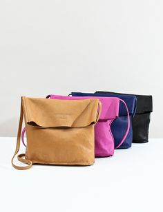 Creatures of Comfort X Baggu Fold Over Leather Purse- Orchid.  Not necessarilly this brand specifically, but the style.  Not pink.