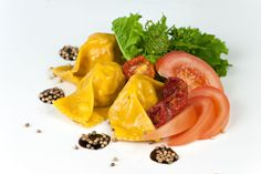 Plin fresh hand made pasta stuffed with eggplants, mozzarella and little tomatoes. By Checco il Pastaio