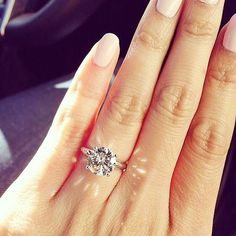 A round diamond-tipped engagement ring