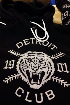 We went with a motorcycle gang vibe on this, simplifying the logo down to the essentials. Adding a timeless appeal, our Detroit Club 1901 Tiger design features white ink hand-screened onto an extremel