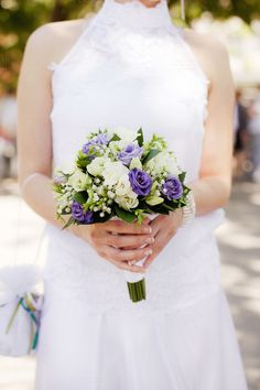 Bride with bouquet, closeup by Wedphoto on Creative Market