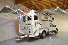 Lance Campers debuts the 2016 Lance a ten-foot, four-inch truck camper with a full-wall slide out and a dry bath. Lance also teases a new model. Pickup Camper, Truck Camper, Camper Trailers, Kenworth Trucks, Ram Trucks, Diesel Trucks, Truck Bed Date, Lance Campers, Cool Rvs