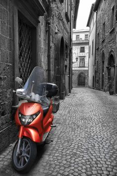 Nothing says Italy quite like the thousands of motor scooters that rumble through the narrow streets of her ancient cities. I discovered this beautiful scooter parked quietly in a remote alleyway in the medieval city of Orvieto, Umbria.