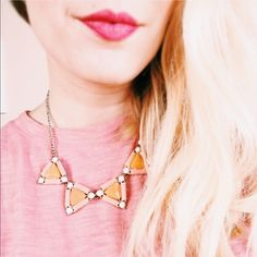 """Coral and Ivory Geo Triangles Necklace Sweet blush, ivory and coral triangle gems necklace with gold chain. Approx. 18"""" long. Worn once, no stones missing, perfect condition. Listing is for necklace only. Francesca's Collections Jewelry Necklaces"""