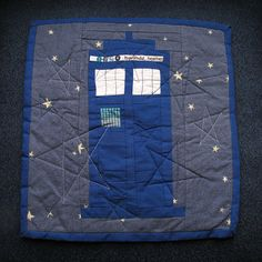 Another TARDIS quilt - it would be cool to stitch the Gallifreyan symbol in there, too.