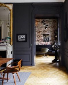 [ Idées déco ] Des moulures et boiseries noires Modern glamour in a Parisian apartment painted a dark charcoal gray and accented with gilded mirrors and modern furniture, Home Interior, Interior Architecture, Interior Decorating, Color Interior, Interior Office, Interior Photo, Interior Ideas, Modern Interior, Style At Home
