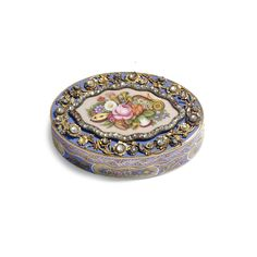 """A JEWELLED GOLD AND ENAMEL """"TURKISH MARKET"""" SNUFF BOX unmarked, Geneva, circa 1840  oval with wave-edged rim, the lid painted en plein with a cluster of summer flowers and musical instruments on a translucent pale pink ground over sunburst engine-turning within a rose diamond-set frame, the border mounted with paste-set flowerheads and leafy scrolls, the azure ground and sides decorated with further flowers, the base with a trophy of vari-coloured flags, flowers and drums"""