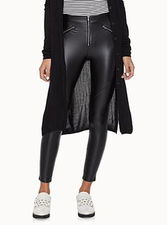 For your inner rocker, thin and very soft faux-leather legging with three zips in front   Soft felt lining   Elastic waistband   Decorative slant pockets    The model is wearing size small