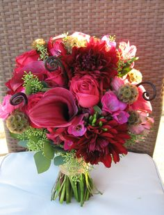 Unique bridal bouquet with, callas,fiddle head,scaribosa,dahlias, freesia,seeds, Designed by Flowers by Antonella