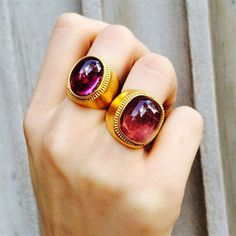 Set in warm 22k yellow gold, these tourmaline rings from ilias LALAoUNIS make a bold statement