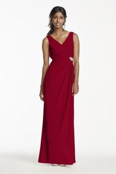 Alluring yet classic, this crepe cowl back dress is one your bridesmaids will want to wear again!  Tank V-neck bodice featuresruching at the back and the side, accented with a crystal brooch for some extra sparkle.  Cowl back detail and a side slit skirt take this dress to the next level.  Fully lined. Imported polyester. Back zipper. Dry clean only.
