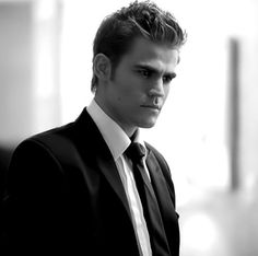 Paul Wesley. All dashing in a suit in this black and white picture, he's even more handsome.