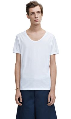 Scoop neck white t-shirt - Simple and essential. The little details on the Acne version make it perfect. I bought the same shirt in three different colours.