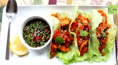 Asian Chicken Lettuce Wraps | a delicious low carb meal.  Cubes of chicken are seasoned with garlic, ginger, and fresh chiles.  These lettuce wraps are served with bell pepper, tomatoes and a tangy dipping sauce.  This dish is great as a light dinner or an appetizer.
