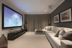 Simple and classical curtains add the finishing touch to this home theatre room