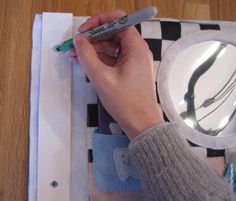 Great tutorial on how to make quiet book pages, including how to add grommets.