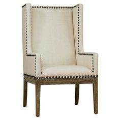 Showcasing a wingback silhouette and nailhead trim, this linen-upholstered arm chair brings chic style to your living room or parlor.