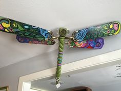 old fan blade dragonfly with glass doorknob eyes and zen-doodle wings https://www.facebook.com/EarthSong-Flowers-973044026047368/?ref=hl