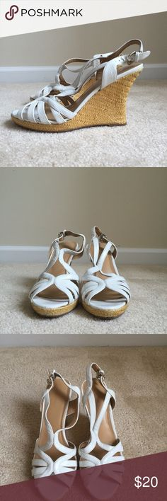 White sandals White sandals gently used.---------------------------NEW TO POSH MARK?  Download the APP and save $5 on your first purchase. Use code URFMR.                                                         --------------------PLEASE BUNDLE! Save 20% on bundles of 3 or more. Nine West Shoes Sandals