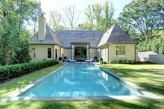 A Bobby McAlpine house in Atlanta. Love the use of the pool as a central axis point of the French Provincial house. Pinned to Pool Design by Darin Bradbury.