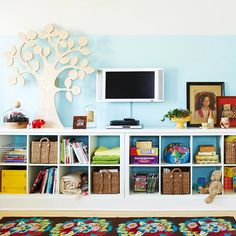 A cubby system keeps toys and books in this playroom organized! More storage ideas for kids' toys: http://www.bhg.com/rooms/kids-rooms/storage/storage-ideas-for-kids-toys/?socsrc=bhgpin061013cubbies=4