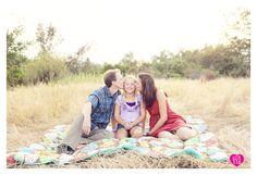 Posing family of three