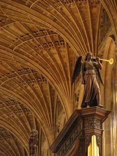 like-distant-thunder:      Music-makers in King's    Constructed between 1666-8, the organ case in King's College chapel is a fine work of art that nicely complements the gorgeous stone vault. Here, we see an angel with a trumpet and King David in the background - both Biblical 'musicians' - who fittingly evoke the famed music that comes from this unique chapel.  Lawrence OP
