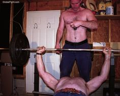two guys working out garage