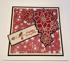 Handmade card. Mixed Media Ink Sprays, Poinsettia panel stencil, Snowflakes Art Stamp, Sparkle Medium.