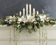 Breathtaking Christmas mantle decor. White Christmas decor.