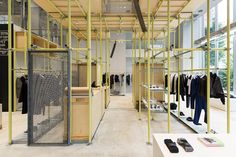 schemata architects installs plastic scaffolding at en route ginza, japan