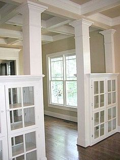 bookcases separating rooms | columns separate the living room from the formal dining room