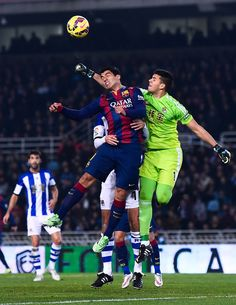 Luis Suarez of FC Barcelona competes for the ball with the goalkeeper Geronimo Rulli of Real Sociedad during the La Liga match between Real Sociedad de Futbol and FC Barcelona at Estadio Anoeta on January 4, 2015 in San Sebastian, Spain.