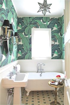 Rosa Beltran Design {Blog} martinique banana frond palm wallpaper wall paper bevery hills hotel bar jungle tropical green frond powder room bathroom hex tile floors clawfoot tub vintage moravian star ceiling light pendant nickel fixtures black chandelier shades sconces sconce shade brass pedestal accent side table WHITE BEADBOARD WAINSCOT BATHROOM BATH ROOM CLAWFOOT TUB ANTIQUE FAUCET BRIGHT CHAIR RAIL WAINSCOTTING WAINSCOTING WAINSCOTE DIPTIQUE CANDLE HOTEL LINENS TOWELS HAND TOWEL