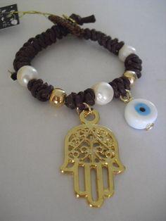 Pulsera con perlas,ojo turco y mano protectora,full protección.