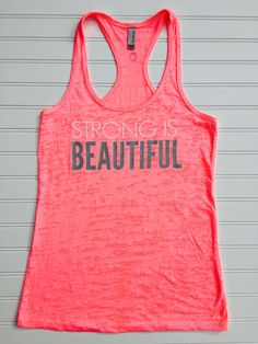 Strong is Beautiful whether is be physical, mental, or spiritual. Let your beauty shine! Neon pink burnout racerback tank