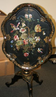 This restoration involved the molded edge, which was broken on this painted paper mache tilt-top table. www.robertburgerfurniture.com
