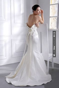 [Well, I like the flower and the streamers.  Too bad they didn't make it a complete gown--you know, with things like sleeves and a neckline and support for the bodice.  And if they're going to have a ruffle higher up, why not include one on the train?]  So cool - Sexy back satin mermaid style wedding dress | CHECK OUT MORE IDEAS AT WEDDINGPINS.NET | #weddings #hair #weddinghair #weddinghairstyles #hairstyles #events #forweddings