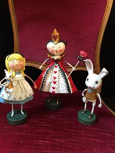 Lori Mitchell figurines celebrating Alice in Wonderland and Alice through the Looking Glass at Jacqueline's Home Decor.