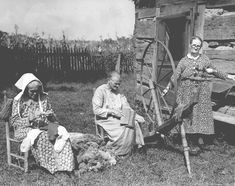 Three mountain women near Spencer, Tenn., spinning, carding and knitting yarn. Tennessee State Library and Archives