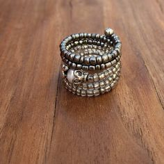 Beaded Adjustable Size 7 Memory Wire Ring with White Pearl and Assorted Silver, Victoria. $12.00, via Etsy.