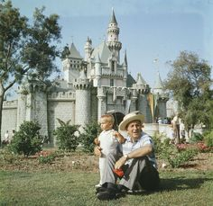Walt and his grandson enjoy the view from in front of Sleeping Beauty Castle.