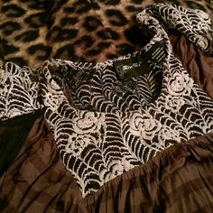 Flash sale! MISS ME ombre crocheted top The first picture shows the back. Brown stripes with black ombre dyed sleeves and bottom. This top has see through floral crochet/lace at the neck, back and shoulders. Beautiful flowy design, like new condition. Miss Me Tops