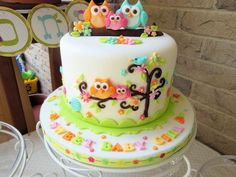 """I made this cute little Owl Family for my daughter's Baby Shower. It is based on the Happi Tree design. The cake is an 8"""" vanilla cake with buttercream icing, covered in fondant with fondant decorations. The cupcakes are dark chocolate with..."""